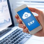 ERP (Enterprise Resource Planning) app on smartphone screen connecting data with cloud computing, access to HR management, production control, accounting